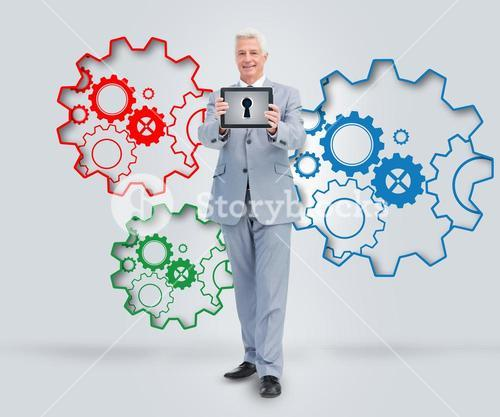 Mature business man presenting tablet