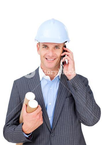 Charming male architect talking on phone