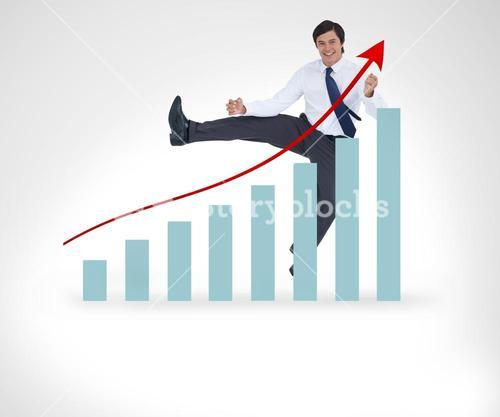 Businessman jumping over the graphical presentation