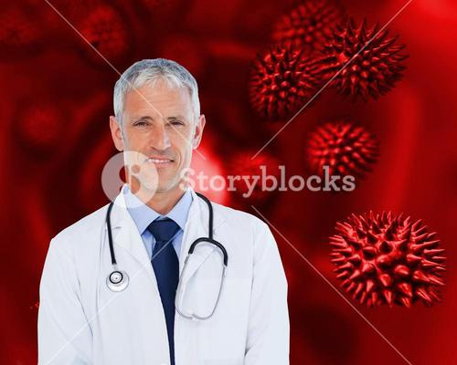 Smiling doctor with stethoscope standing against a background