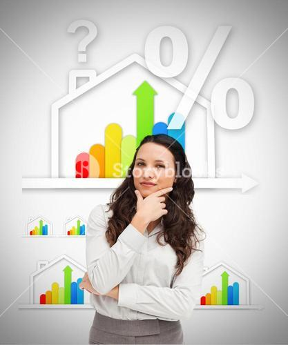 Woman standing against energy efficient house graphic