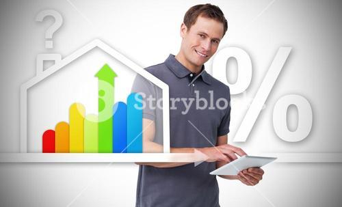 Man standing behind the energy efficient house graphic