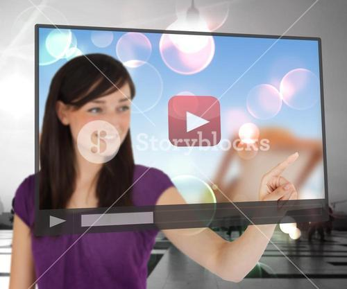 Smiling woman using touch screen