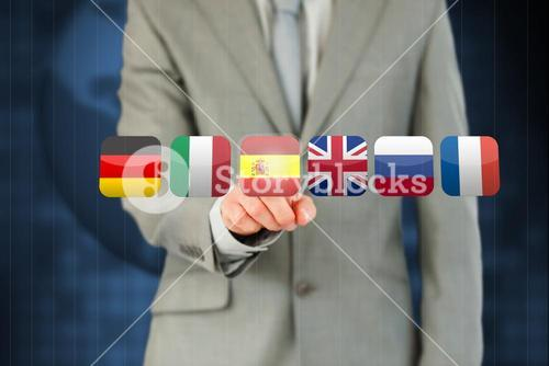 Businessmans finger activating state flags on touchscreen