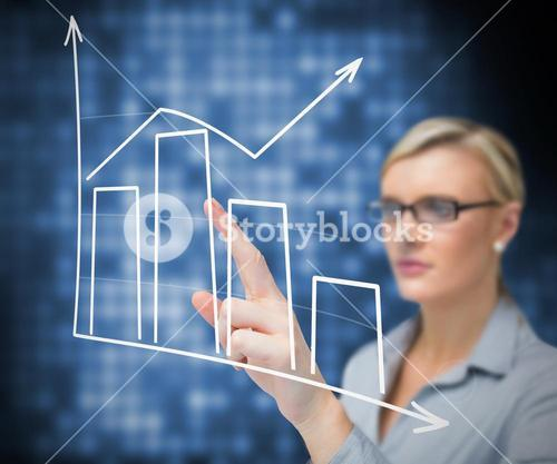 Businesswoman using touch screen against a blue background
