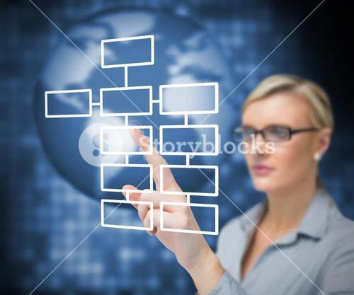 Businesswoman pressing button on touch screen