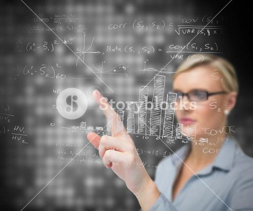 Businesswoman using patterns on touch screen