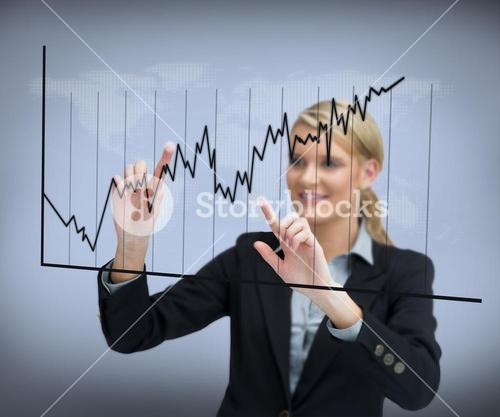 Businesswoman using curve on touch screen