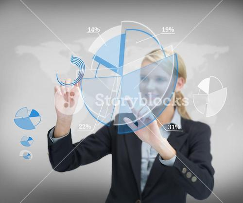 Businesswoman working with graphs against background