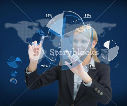 Smiling businesswoman touching screen with graphs