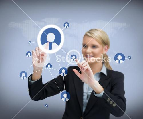 Businesswoman using touch screen with contacts on people