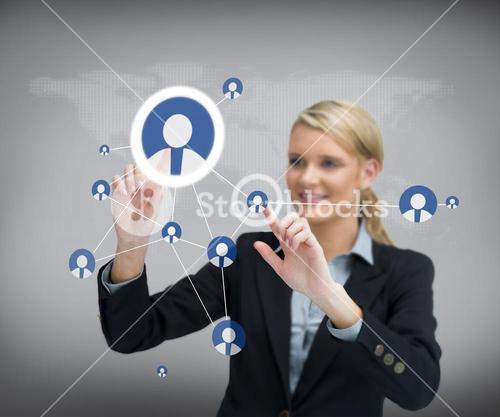Businesswoman standing before touch screen