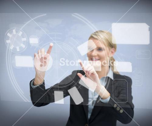 Smiling businesswomans finger touching screen