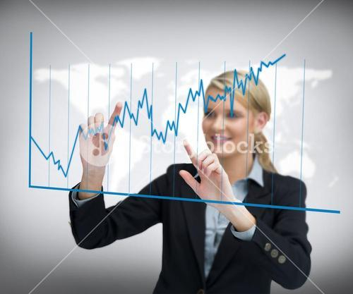 Smiling businesswoman using curve on touch screen