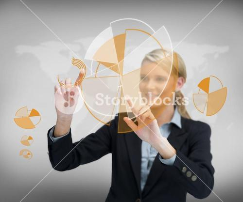 Smiling businesswoman working with graphs