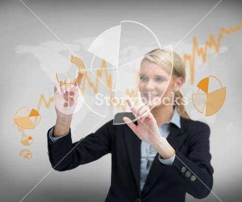 Businesswomans finger touching graphs on the screen