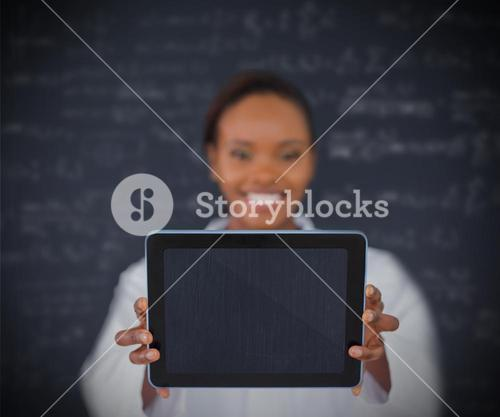 Smiling businesswoman holding a tablet