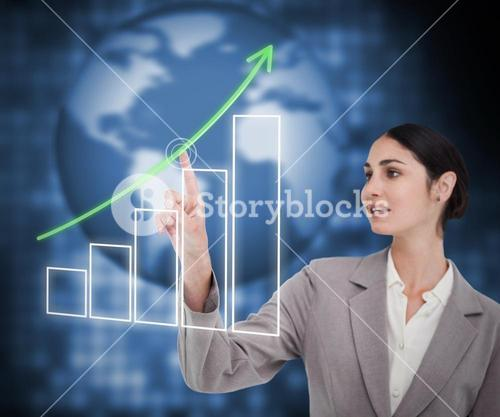 Brunette businesswoman working with touch screen