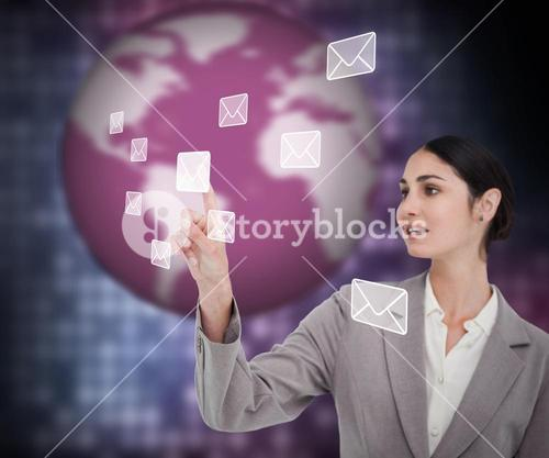 Businesswoman working with envelopes on touch screen