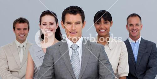 Positive business team in front of the camera