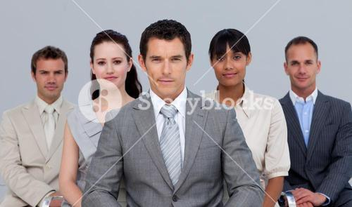 Business team sitting in front of the camera