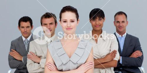 Confident business team with folded arms