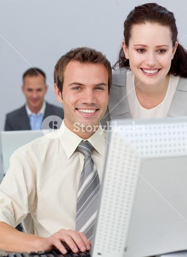 Charming businesswoman helping her colleague