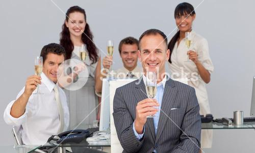 Successful business coworkers toasting with Champagne