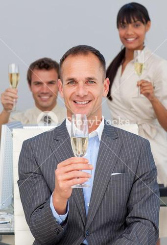 Business coworkers toasting with Champagne