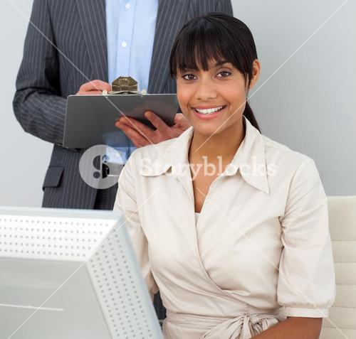 Manager checking his employees work