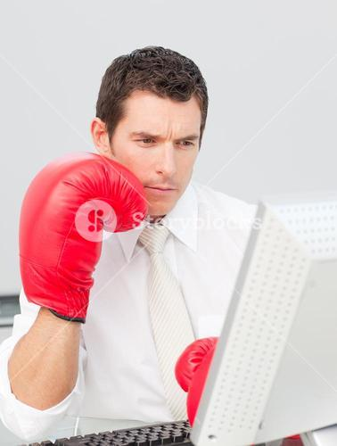 Businessman boxing himself in the face