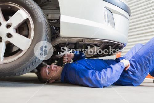 Auto mechanic under car
