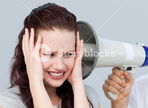 Portrait of a businesswoman getting nervous with a megaphone