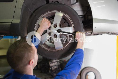 Mechanic fixing car tire
