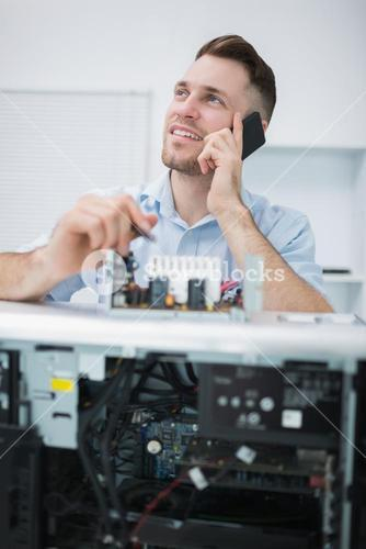 Computer engineer working on cpu part while on call in front of open cpu