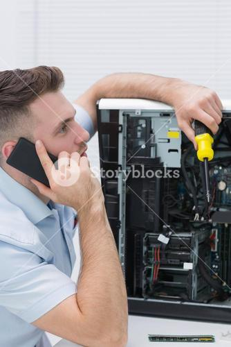 Young computer engineer working on cpu while on call