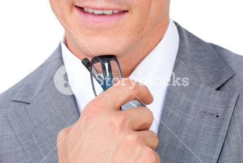 Close up of a businessman holding glasses