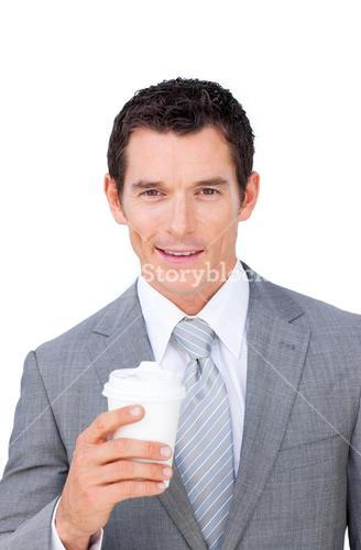 Charismatic businessman holding a drinking cup