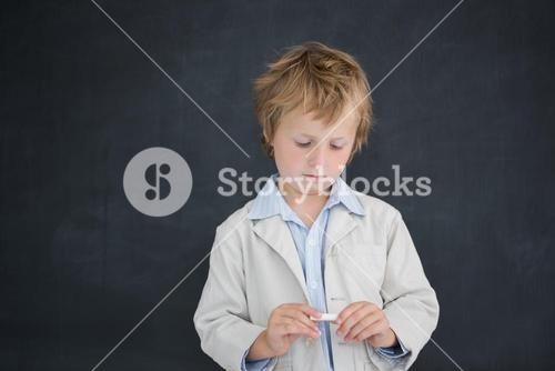 Boy as teacher in front of black board