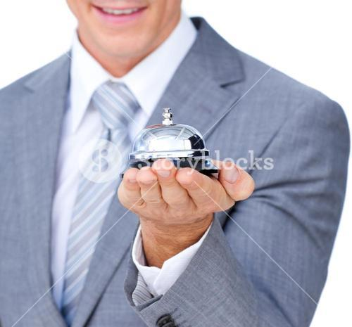Close up of a businessman holding a service bell