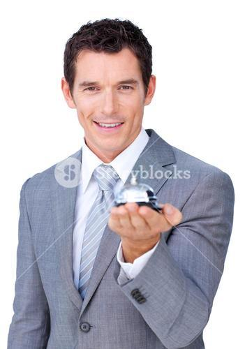 Assertive businessman showing a service bell