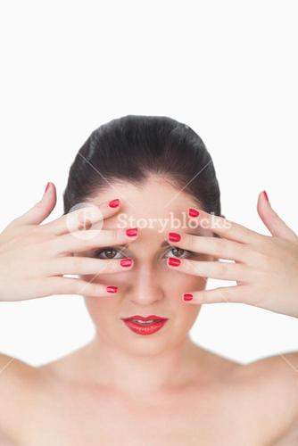 Woman with red lips and red painted finger nails over face