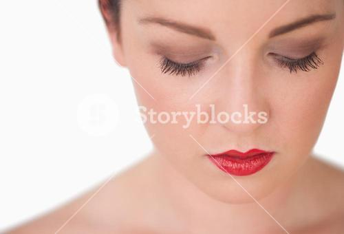 Closeup of young woman with red lips