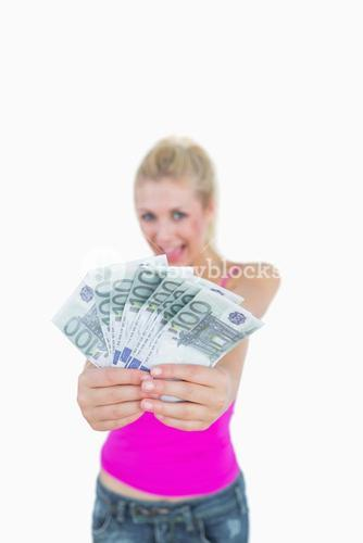 Woman holding out fanned 100 euro banknotes