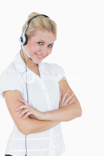 Portrait of young female executive wearing headset