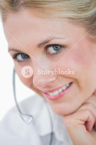 Closeup portrait of young female executive wearing headset
