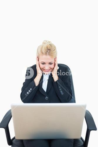 Successful young business woman with laptop