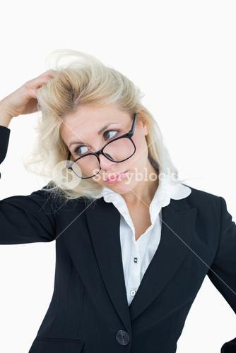 Frustrated business woman scratching head