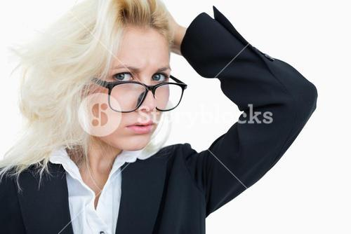 Closeup portrait of frustrated business woman scratching head