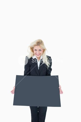 Portrait of business woman holding empty banner